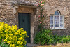 An old door entrance in the village of Lacock, Wiltshire, England.
