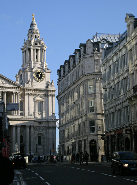 Looking up Ludgate Hill in the City of London, with one corner of St. Paul's visible.