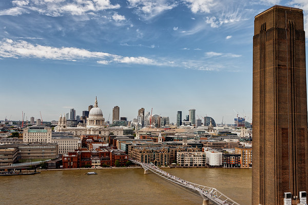 View of St Pauls and Millenium Bridge from the Tate Modern with its chimney