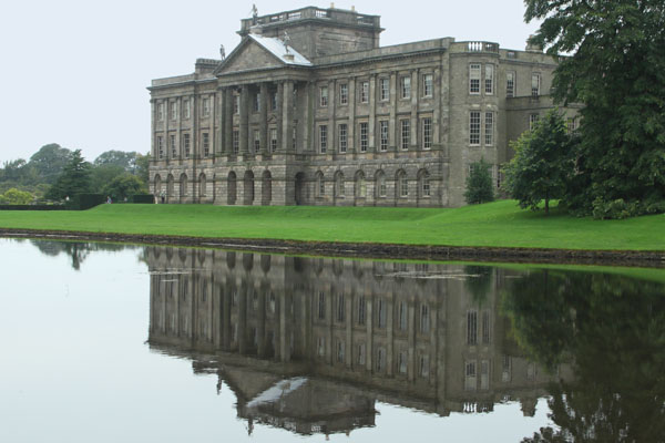 Back view of Lyme Park from across the pond. Behind the house is a pond with a scenic woodsy trail which also passes by the gardens.