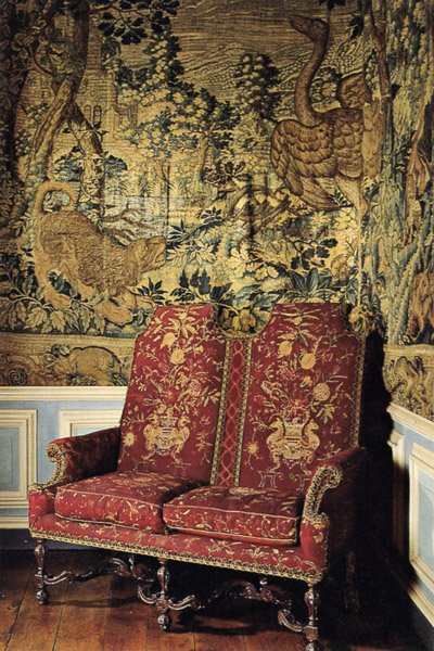 Settees in the Yellow Bedroom at Lyme Park, circa 1690, upholstered in silk-embroidered wool.