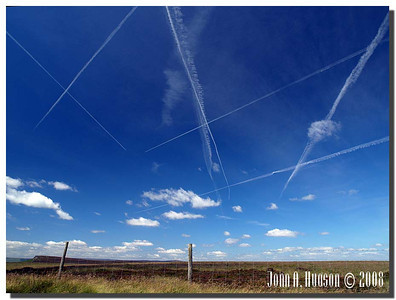 786_J7213254-UK : Contrails above Hallam Moors to the east of Stanage Edge.
