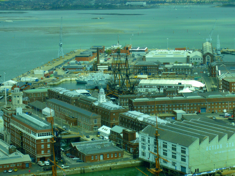 Seen here, from the Spinnaker Tower, Portsmouth England, is HMS Victory, the Royal Navy's most famous warship and  the world's oldest commissioned ship. She is a proud memorial to Vice Admiral Lord Horatio Nelson, Britain's greatest Naval hero.  <br /> <br /> In No. 2 dry dock, HMS Victory is one of the most famous warships ever built. Built between 1759-1765, Victory was a first-rate, ship-of-the-line. In 1805, Vice Admiral Lord Nelson on board his flagship, HMS Victory, led 27 British ships into battle off Cape Trafalgar against a much larger combined French and Spanish fleet.