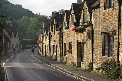 "Castle Combe, 12 miles from Bath, has been voted the ""prettiest village in England"" many times. It was an active weaving center and marketplace for centuries."