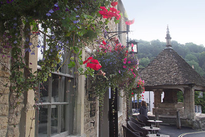 Many homes and businesses, such as this restaurant in the center of the village, are adorned with flowers.