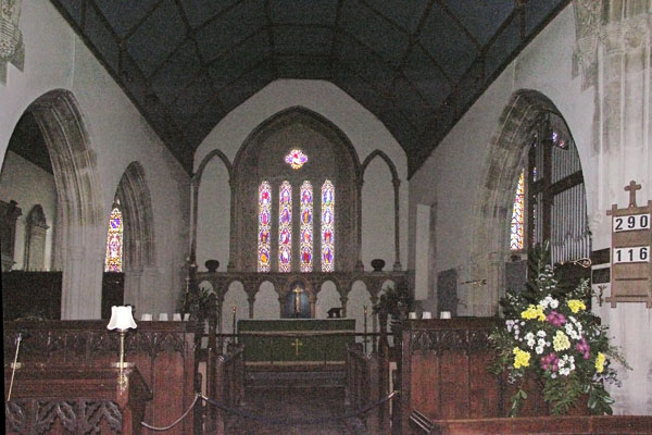 Inside St. Andrew's Church in Castle Combe, a 12th century church. The picture is grainy because I took it inside the dark church, and later lightened it considerably.