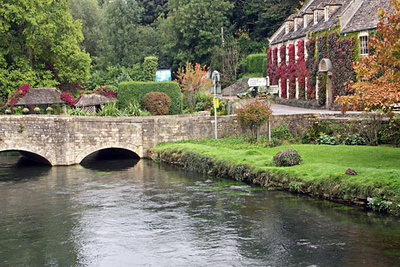 """Bibury is a beautiful village on the River Coln, 9 miles from Burford in the Cotswolds. Here you can see the bridge over the River Coln. William Morris considered Bibury to be the """"most beautiful village in England."""""""