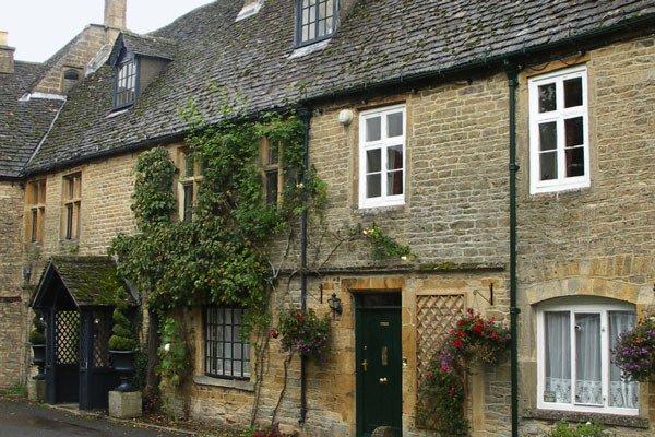 Houses in Stow-on-Wold. Stow-on-Wold is on the Coln Way, a popular walking path. Like other areas of historic interet in England, both residents and shopkeepers must adhere to regulations pertaining to the appearance of their buildings.
