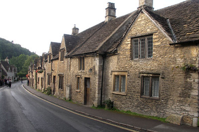 Again, the main street of Castle Combe illuminated by sunlight.