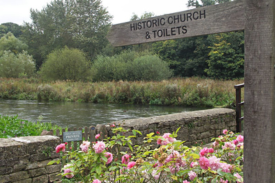"""I doubt if there are signs indicating """"Historic Church and Toilets"""" anywhere but in England. Now is this meant to imply that the toilets are also historic?"""