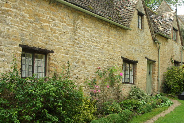 Another house in Bibury, with golden limestone