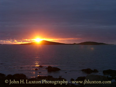 Sunset over The Twin Hills of Samson, Isles of Scilly. July 30, 2005.