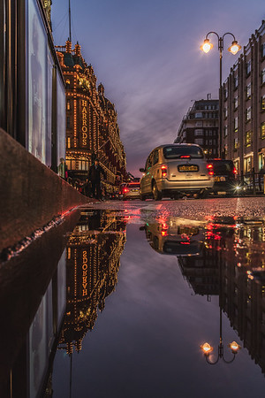 Reflection of Harrods Departmental Store in London.