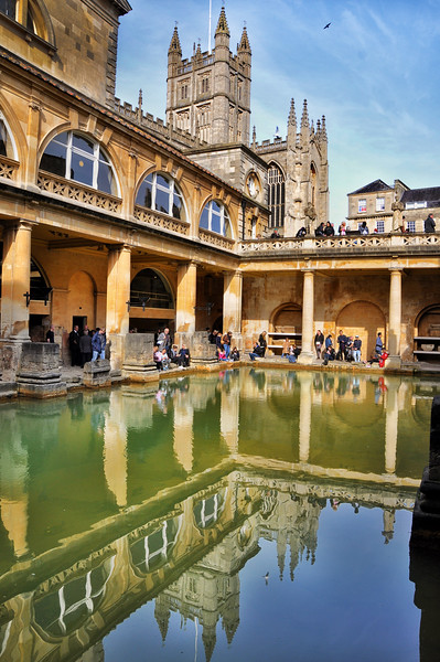 Reflection of Bath Abbey in Roman bath. 2016.