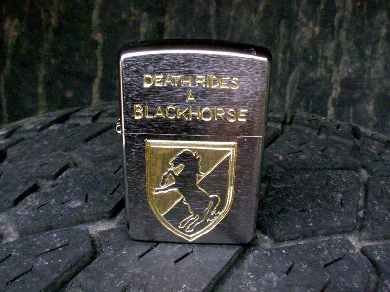 Finished engraving of the BlackHorse side of the lighter.