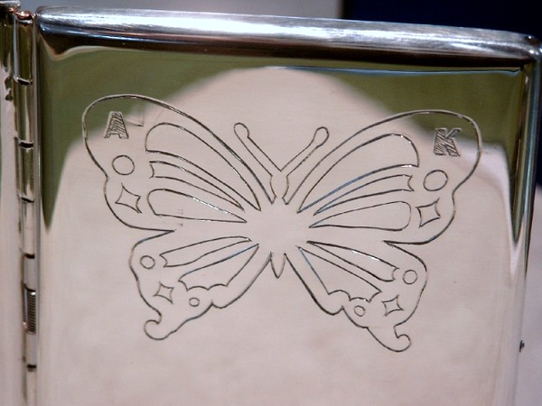 Butterfly and initial engraved on the cover of a cigarette case I made.
