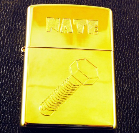 Hand engraved Zippo Lighter.<br /> The client's first AND last name are included in the view you can see. <br /> <br /> Can you tell me what the customer's last name is?