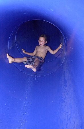 Foster Shamburg slides down a waterslide at the YMCA circa June 2003.