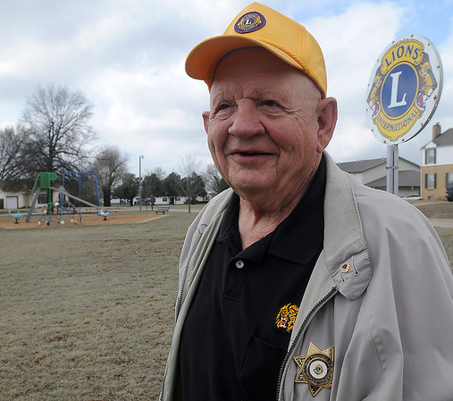 Ron Schulz pauses near the Lions International sign at Lions Park Thursday, April 04, 2013. Schulz, a member of the North Enid Lions Club, helps with the maintenance of the local park and has worked with the Public Library of Enid and Garfield County Advisory Board on the construction of the library at its present location. (Staff Photo by BONNIE VCULEK)