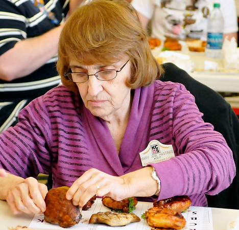 Mary Ann Hastings begins judging Saturday during the Smokin' Red Dirt Barbeque contest in downtown Enid. (Staff Photo by BILLY HEFTON)