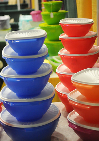 Cindy Skinner displays colorful tupperware products during the Enid Home Show at the Chisholm Trail Coliseum Friday, April 26, 2013. The annual event continues through Sunday. (Staff Photo by BONNIE VCULEK)