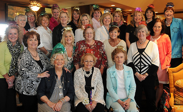Members of the D.O. Chapter of PEO celebrate their 67th birthday in the home of Lori Markes Friday, April 5, 2013. Donna Messall, Gail Hackett and Bea Simpson (seated in the front row, from left) have been active in the chapter for 38, 50 and 50 years respectively. (Staff Photo by BONNIE VCULEK)