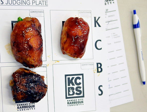 A judges plate of barbeque to be judges Saturday during the Smokin' Red Dirt Barbeque contest in downtown Enid. (Staff Photo Illustration by BILLY HEFTON)