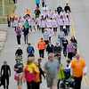 Walkers approach the turn around near Northern Oklahoma College-Enid as they fill one lane on E. Maine in support of the 81st annual March for Babies during the March of Dimes event Saturday, April 27, 2013. Participants began the 5K at David Allen Memorial Ballpark and then returned for awards, games and food. (Staff Photo by BONNIE VCULEK)