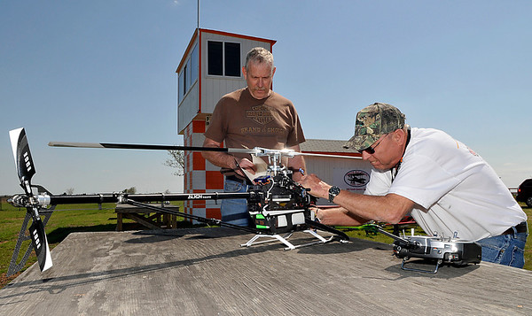 Ron Rush (right) and Bill Cunningham ready a helicopter for flight at Boomer Field Sunday, home of the SPADs RC Club. The club will have a special ceremony Saturday as they raise a flag over Boomer Field that once flew over Afghanistan.(Staff Photo by BILLY HEFTON)