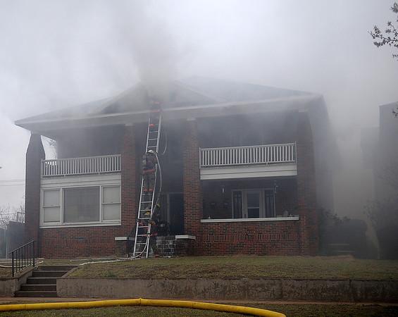 Firefighters battle a blaze at 412 W. Pine Wednesday, April 17, 2013. (Staff Photo by BONNIE VCULEK)