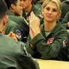 2nd Lt. Kayla Bowers applauds during the CUI Picnic Awards Ceremony at the Armed Forces Reserve Center Thursday, April 18, 2013. Bowers is a member of the Vance Air Force Base Class 13-13. (Staff Photo by BONNIE VCULEK)
