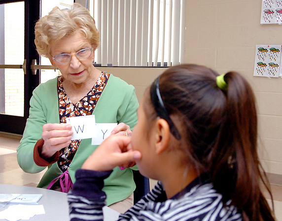 Hoover Elementary foster grandparent, Mary Stowe, works with Taylyn Canchola. (Staff Photo by BILLY HEFTON)