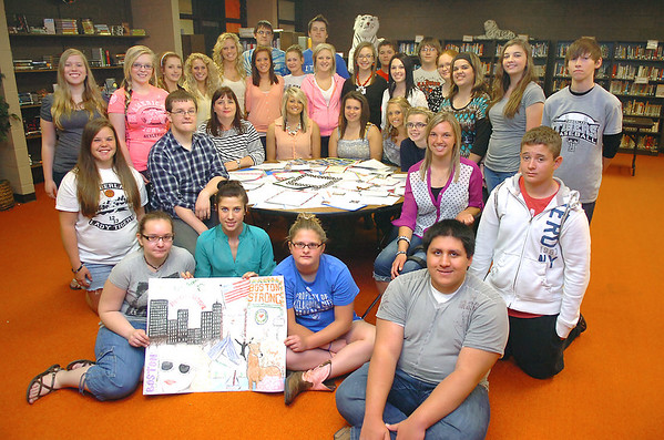 Students from the English and German classes at Timberlake High School pose with the letters that they have written to the victims of the bombing in Boston. (Staff Photo by BILLY HEFTON)