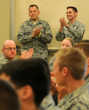 2nd. Lt. Thomas Barger (top, right) Deputy Chief of the 71st Flying Training Wing Public Affairs, applauds during the CUI Picnic at the Armed Forces Reserve Center Thursday, April 18, 2013. 2nd Lt. Barger was among those honored during the awards ceremony. (Staff Photo by BONNIE VCULEK)