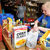 Erica Wichert was among the volunteers sorting through food items donated to Horn of Plenty during their spring food drive Sunday. (Staff Photo by BILLY HEFTON)