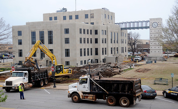 A Garfield County Sheriff crime scene tape surrounds the construction area at the Garfield County Courthouse as crews remove old concrete Tuesday, April 9, 2013. New sidewalks and additional parking will be available once construction is complete. (Staff Photo by BONNIE VCULEK)