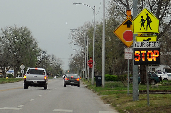 Drivers approach the new east/west STOP signs at 10th and E. Maine Tuesday, April 16, 2013. The new All-Way Stop was established Monday morning after several accidents at the location. Enid Police officers have written more than 20 warnings to drivers who have run the signs since yesterday. (Staff Photo by BONNIE VCULEK)