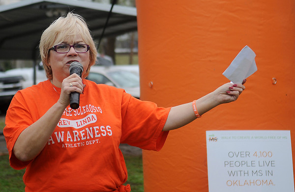 Rev. Linda Pope, from the Garber Methodist Church, stands near a Multiple Sclerosis sign indicating that over 4,100 people live with MS in Oklahoma before the start of the 2nd annual Garber MS Walk Saturday, April 27, 2013. (Staff Photo by BONNIE VCULEK)