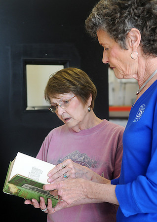 Gerry Lou Brown (left) and Cathy Wiles evaluate an early edition of a book at Hospice Circle of Love Tuesday, April 9, 2013. The annual book sale begins Friday at 9 a.m. at 314 S. 3rd. (Staff Photo by BONNIE VCULEK)