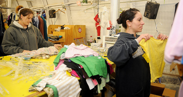 Tabatha Whittington (left) and Sara Gutierrez sort and price clothing donations at Park Avenue Thrift Wednesday, April 03, 2013. (Staff Photo by BONNIE VCULEK)