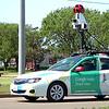The Google maps street view car drives along west Garriott Tuesday. (Staff Photo by BILLY HEFTON)