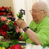 Betty Walters creates a Memorial Day wreath at Enid Senior Citizens Center Tuesday, April 9, 2013. (Staff Photo by BONNIE VCULEK)