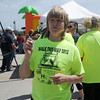 Ann Bryant explains the Walk This Way 2013 registration process during the kick-off at the Cleveland Trailhead on the Enid Trails Saturday, April 13, 2013. (Staff Photo by BONNIE VCULEK)