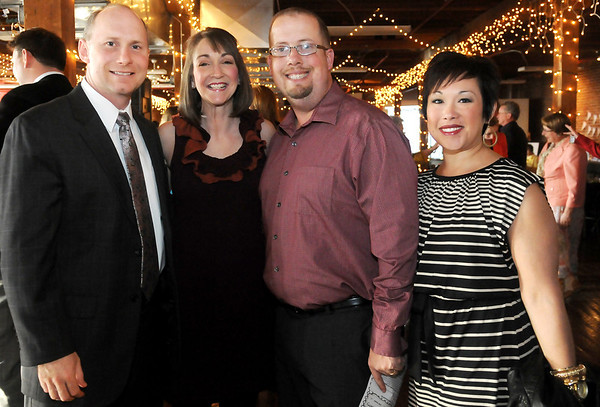 Scott and Christy Northcutt and Eli and Angelica Berry (from left) (Staff Photo by BONNIE VCULEK)