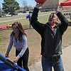Sadee Lewis (left) and Tyler Eskue shoot hoops at Northern Oklahoma College's Spring Fling Thursday, April 11, 2013. (Staff Photo by BONNIE VCULEK)