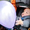 Hudson DePriest, the ambassador for the March of Dimes' March for Babies, reaches for a balloon at David Allen Memorial Ballpark Saturday, April 27, 2013. DePriest is the son of Dr. Kirk DePriest and Barbara Ann DePriest of Enid. (Staff Photo by BONNIE VCULEK)