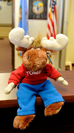 A stuffed Tommy the Moose animal sits on the reception desk at the Garfield County Sheriff's Department Thursday. A box of the stuffed animals were donated to the sheriff's department by the local Moose Lodge and will be given to children involved in unfortunate situations. (Staff Photo by BILLY HEFTON)