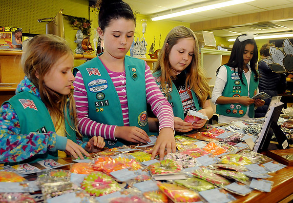 "Katie Roberts, Emma Harbuck, Cailey Luskey and Mallory Smith, from the Girls Scouts of Western Oklahoma Council Troop 211, deliver nearly 100 handcrafted items to Hope Outreach Thrift Store Thursday, April 18, 2013. The ""Sparkling Hope"" items include skills of knitting, crochet, jewelry making, original artwork, card making and duct tape crafts. Roberts, Harbuck, Luskey, Smith, Caitlyn Benge and Carleigh Stallcup spent approximately 120 hours creating the items as a fundraising project for Hope Outreach. The girls will be honored as Bronze Award recipients at the University of Central Oklahoma in Edmond on May 4th. (Staff Photo by BONNIE VCULEK)"