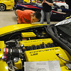 Cody Moore peers under the hood of a 2006 Z51 Corvette Coupe owned by Kevin Lowe during the 21st Annual Corvette Club Car Show at the Chisholm Trail Coliseum Saturday, April 6, 2013. Moore attended his first car show at the age of 10, and his mother, Angie Burch (back, right) snaps his photo next to the vehicles he likes. (Staff Photo by BONNIE VCULEK)