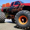 Blake Kunkel peers from inside the wheel of the Sudden Death monster truck as he plays on his Grandpa Bruce Kunkel's toy at Meadowlake Park Sunday, April 21, 2013. (Staff Photo by BONNIE VCULEK)